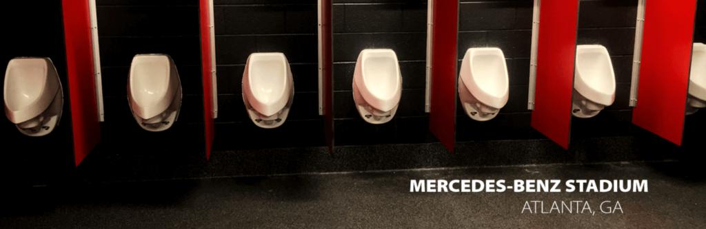 waterless urinals in stadium toilet